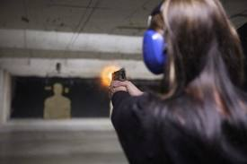 female pistol range shooting